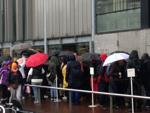 Waiting to get into the Anne Frank Hous.  Their lovely staff did come out and provide umbrellas.