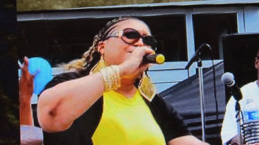 This photo of Renee, is from their website during a performance with Traxx9 Band.