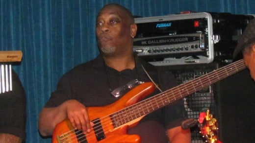 Teddy Robinson, performs on bass guitar for Traxx9 Band.