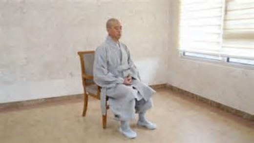 Meditation sitting with back straight.