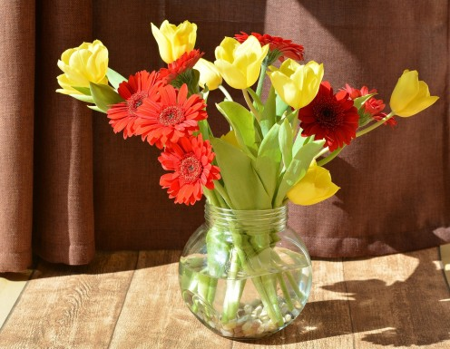 Spring flowers (gerbera and tulips) look pretty in a simple vase.
