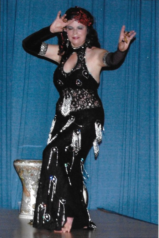 An Egyptian style belly dancing  costume is a fitted one piece garment fastened in the back with a zipper. The Egyptian law requires a dancer's body to be covered.
