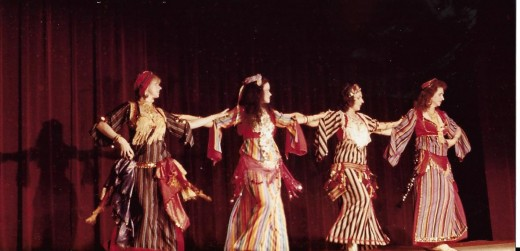 Dancers performing an ethnic dance with Ghawazee costumes.