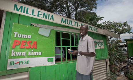 A man withdrawing money from an M-Pesa stall