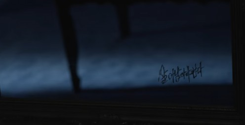 The writing on the mirror at 1:11.