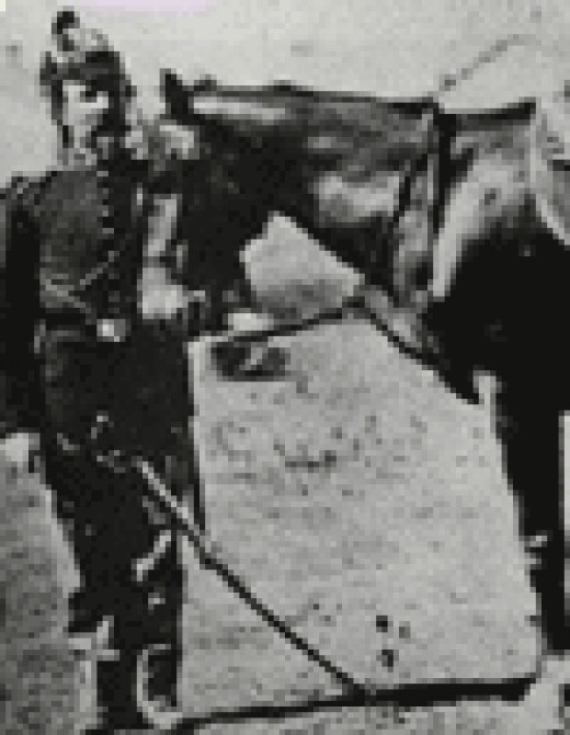"""Sgt. Jeremiah """"Darby"""" Finley with his faithful horse Carlo"""