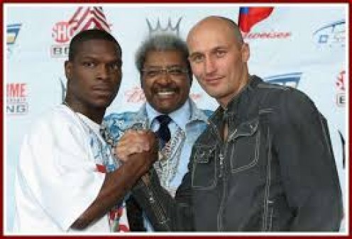 From left to right, Leon Spinks, jr., Don King, and Roman Karmazin.