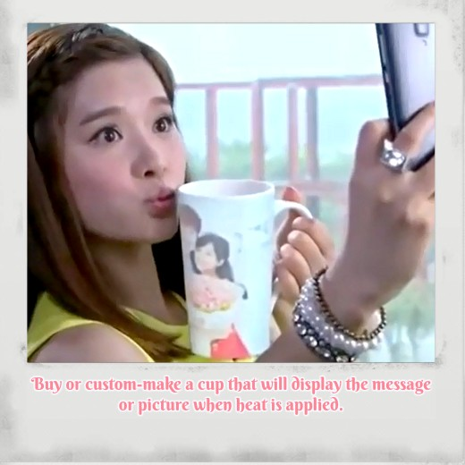 """Zhao Xiao Qi played by actress Yi Niki takes a picture with a """"Magic Mug"""" in Chinese Drama called """"A Different Kind of Pretty Man""""."""