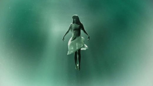 Hannah submerged in water.