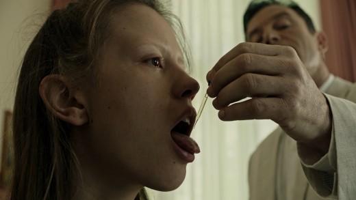 Dr. Volmer feeds Hannah the cure.