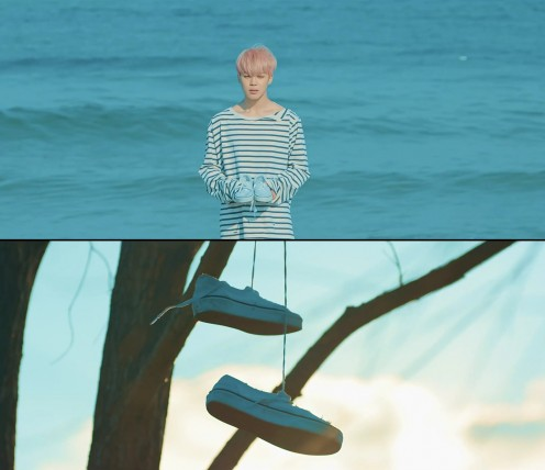 Jimin holding the sneakers and them later hanging from the tree.