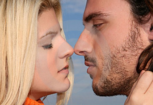 Engaging in a passionate kiss is one romantic dates at home idea you should put to practice