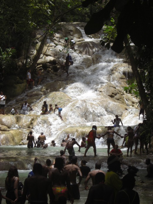 Climbing the majestic Dunn's River Waterfalls is a great thing to do with kids in Jamaica.
