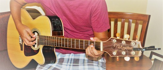 My brother playing his guitar :)