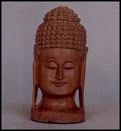 Lord Buddha Idol made out of Sandal Wood - Images courtesy heritagearcade.com