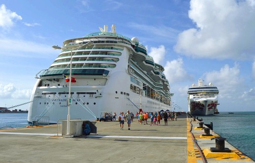 Cruise ships stand over the docks at the St. Maarten cruise port.