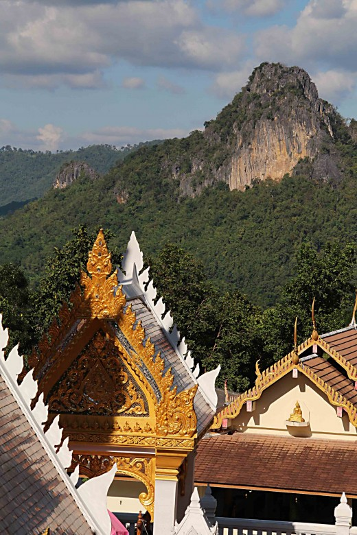 Forest covered mountains and golden temples - it could only be Thailand