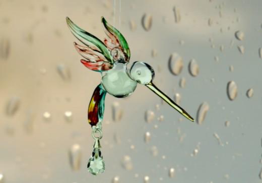 Glass hummingbird sun catcher, not anatomically correct.