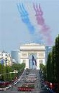 A Large Parade Is The Centerpiece Of Bastille Day Festivities