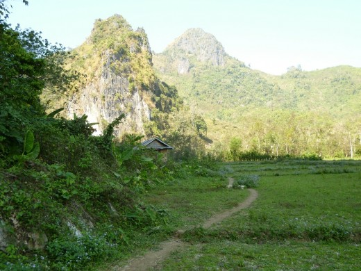 Caves located in typical Laotian Hills