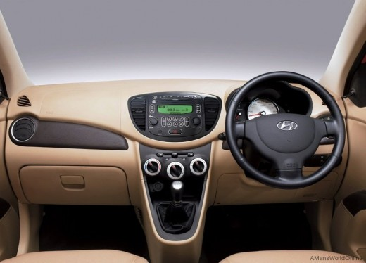 Hyundai i10 dashboard, steering, gear box and interiors.
