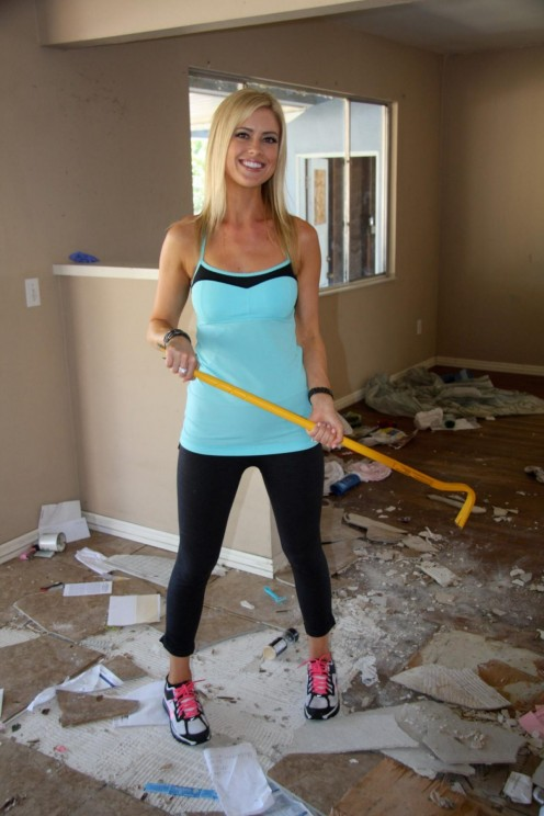 Christina hard at work  tearing down inside of home  that she is redesigning for resale.