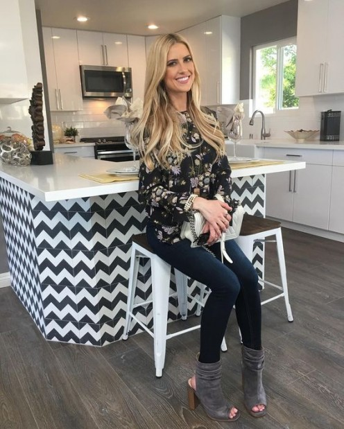 Close up of Christina El Moussa on the set of Flip or Flop.