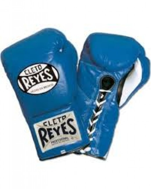 Professional boxing gloves vary from 8 ounce to 12 ounce depending on the weight class and the fight contract.