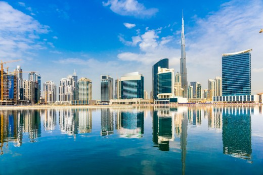 Dubai skyline with reflection in the water.