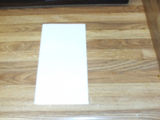 Fold the card in half vertically.