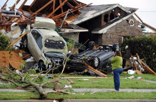 The damage left in the wake of a powerful tornado that torn through a quiet neighborhood.