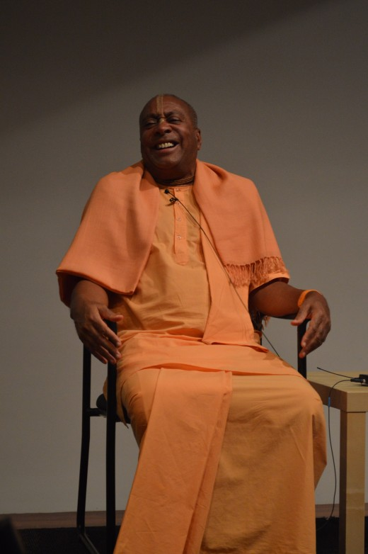 Devamrita Swami, all smiles as he spoke on the Bhakti yoga philosophy of happiness.