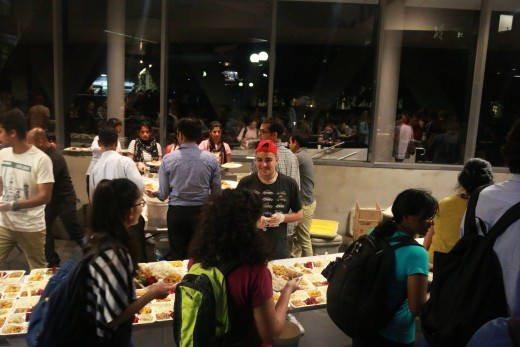 Volunteers serving an all vegan dinner to guests after the talk.