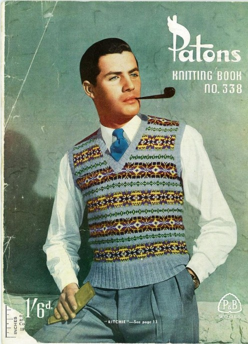 Wow! This male model is not only bold as he is wearing a sleeveless sweater, but smoking a pipe--both strong symbols of intellect, good grooming, and elite level of life.