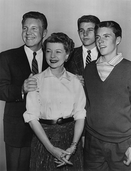 In this unique photo, Ozzie Nelson, (first from left), is wearing a suit when on camera he would be wearing a sweater. Nelson's close friends said that he could be somewhat of a handful.