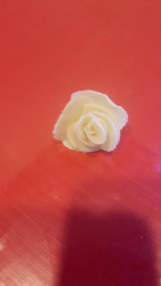 A finished modeling chocolate rose