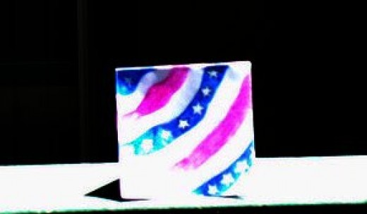 Leave room for another wavy white stripe, and the then add another wavy blue stripe with stars on the inside.  Now your card is completed and has captured the spirit of the American flag.