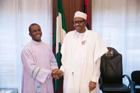 Fr. Mbaka in a warm handshake with Nigeria's President Muhammadu Buhari.
