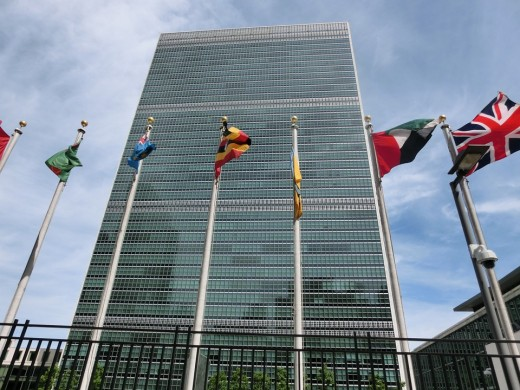 The United Nations HQ is located in the Turtle Bay neighborhood of Manhattan, overlooking the East River.  Flags of the member states are arranged in alphabetical order outside.  NYC is a major center for international diplomacy.