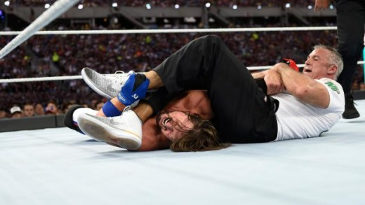 Shane puts an arm bar on AJ at WM33. Photo:WWE