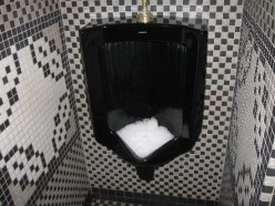 Why do some bars / clubs have ice in the urinals?