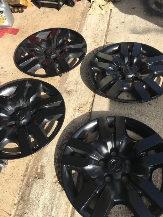 Finished hubcaps. 3 coats of primer, 4 coats of paint, and 3 coats of clear coat later.
