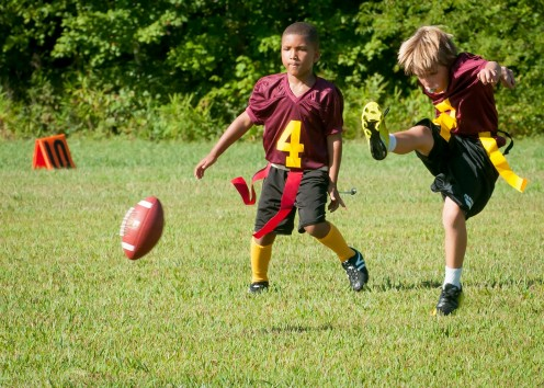 Young kids involved in sports is a healthy form of exercise.