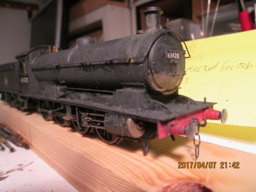 Initial weathering begun on the locomotive body, underside and motion to complete as well as tender underframe. See below...