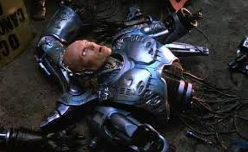 In Robocop, Peter Weller plays a police officer who gets shot to death but then returns as half man and half machine.