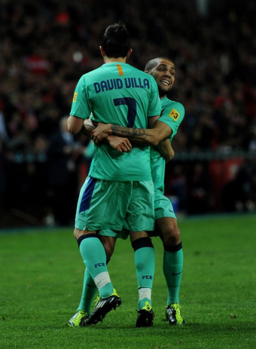 David Villa and Dani Alves was signed by Guardiola from rivals Valencia and Sevilla respectively