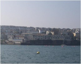 A picture of the Greenbank Hotel looking from the river.  The words Greenbank Hotel can be seen in white on the hotel's private quay.