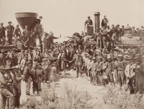 "The eastern and western groups of workers meet and shake hands during the driving of the ""last spike"" into the railroad at Promontory Summit, Utah, in 1869."
