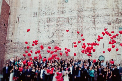 Red balloons for a group photo