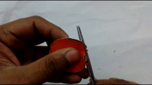 Cut out the orange shape using a pair of scissors.
